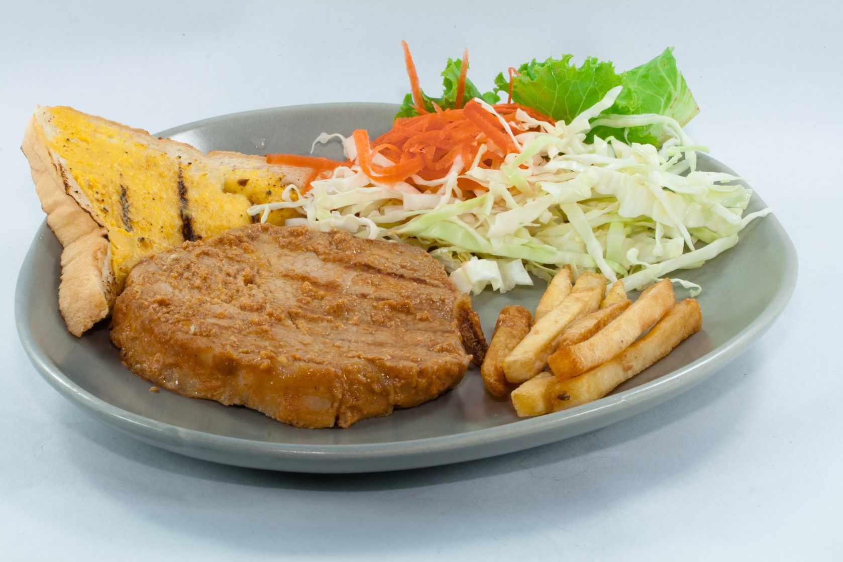 14006368 – porksteak with salad and butter bread